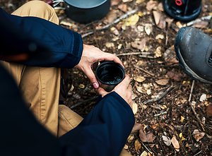 About MensWork. men drinkingtea around fire